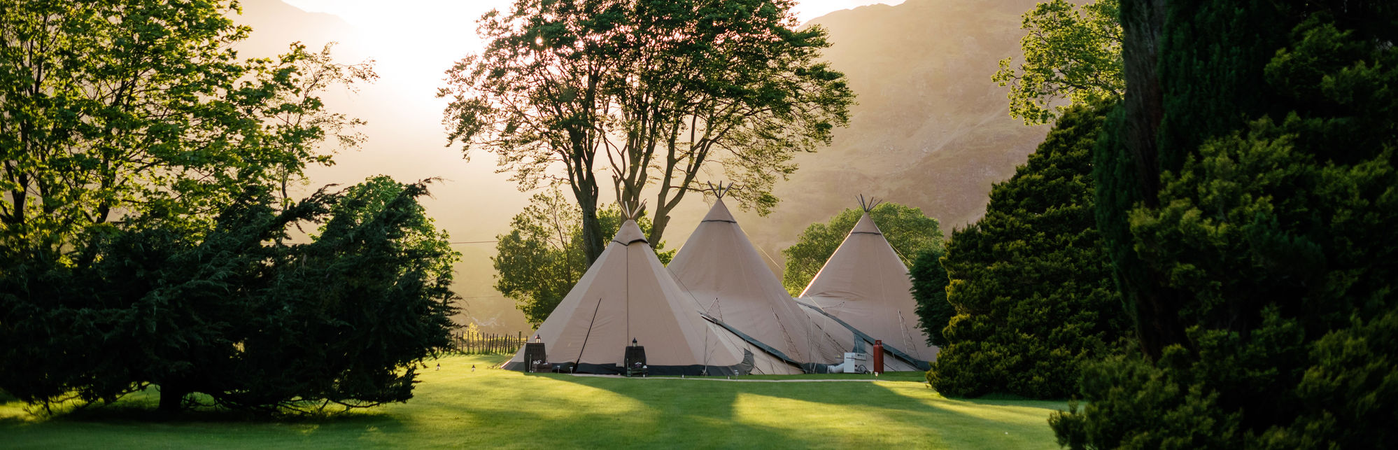 3 tipis in sun light